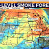 Wildfires burn here, while wildfire smoke impacts across the US