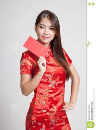 asian in chinese cheongsam dress with red envelope stock