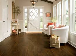 Amendoim Flooring Pros And Cons by Rich Brown Wood Plank Flooring Luxury Vinyl Lvp Foyer