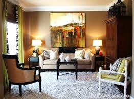 Brown Couch Room Designs by Design Dilemma What To Hang On The Big Wall Behind Your Sofa
