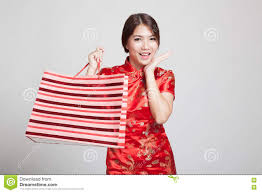 asian in chinese cheongsam dress with shopping bag stock